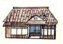 トタン葺屋根の住居